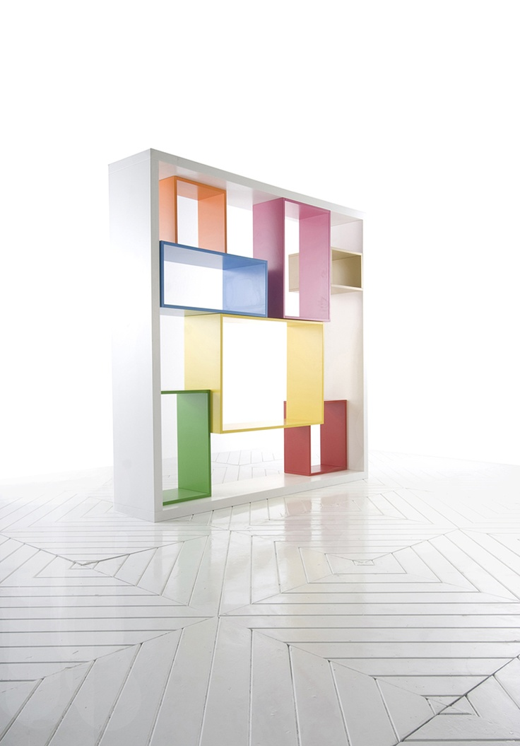 """Conscienti, bookshelf that originated as a class project between Prof. Arch. Lapo Binazzi and his Master Student, Bethany Jacobsen. Made of brightly painted MDF panels, the juxtaposing primary colors accentuate the innovative qualities of this adaptable object. """"The piece became independently architectural, released from any dependency on a wall - meant instead to create or define space on its own."""" comments Jacobsen."""