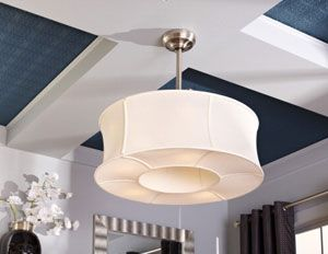 Ceiling fan with drum lamp shade. Enclosed fan - brilliant idea!