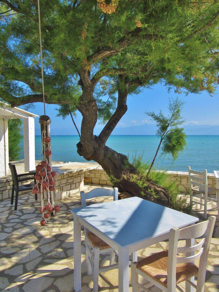 """ The Boathouse "" Beachfront cafe, Roda, Corfu, Greece"