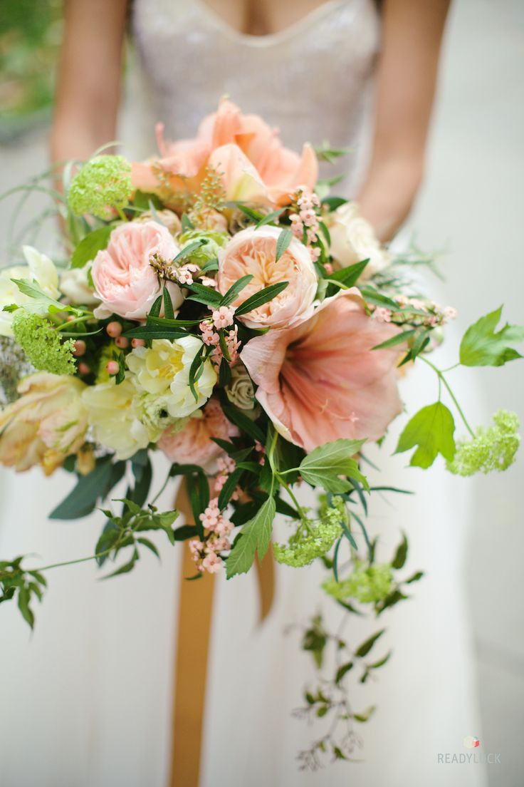 Pink wedding bouquet with garden roses, tulips, and lilies | Lindsay Hite of Readyluck | Brides.com