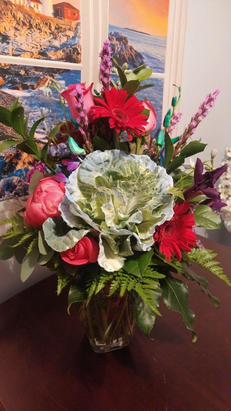Baby boy bouquet with blue tinted kale, Pink Floyd roses, ciral charm peonies, liatris and red gerber daisies. This is a Arizona summer arrangement. #floweringkale #pinkfloyd #coralpeonies #blueflowers #babyboyflowers #Lighthouseflowershopmesa