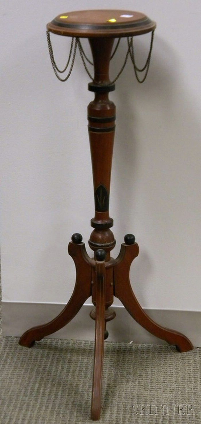 Renaissance Revival walnut stand with brass chains