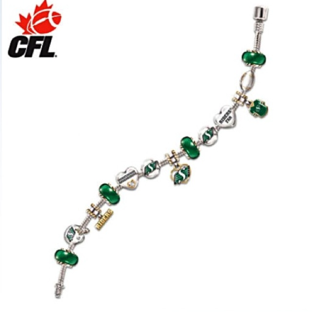"Saskatchewan Roughriders Bradford Exchange Bracelet - Got'a look into this.  It's different.  but if it's anything like the ring, the logo-ed items are far too small to detect without having the item about 18"" from your eyes."