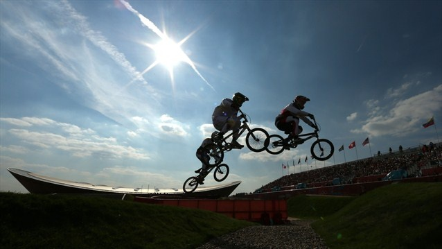 Riders clear a jump during the men's BMX Cycling quarter-finals on Day 13 of the London 2012 Olympic Games.