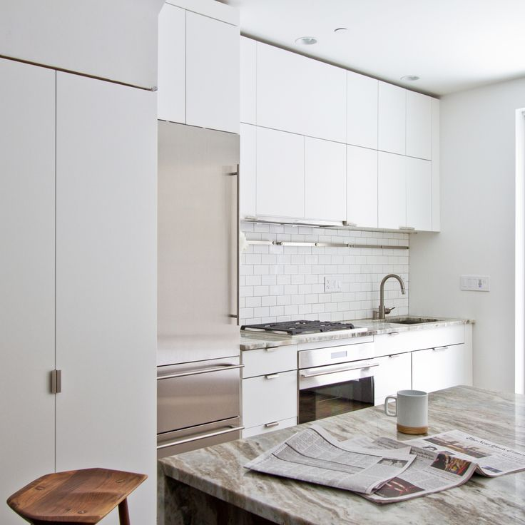 The white interior, in addition to presenting the home as a potential blank canvas, helps reflect ample natural light.