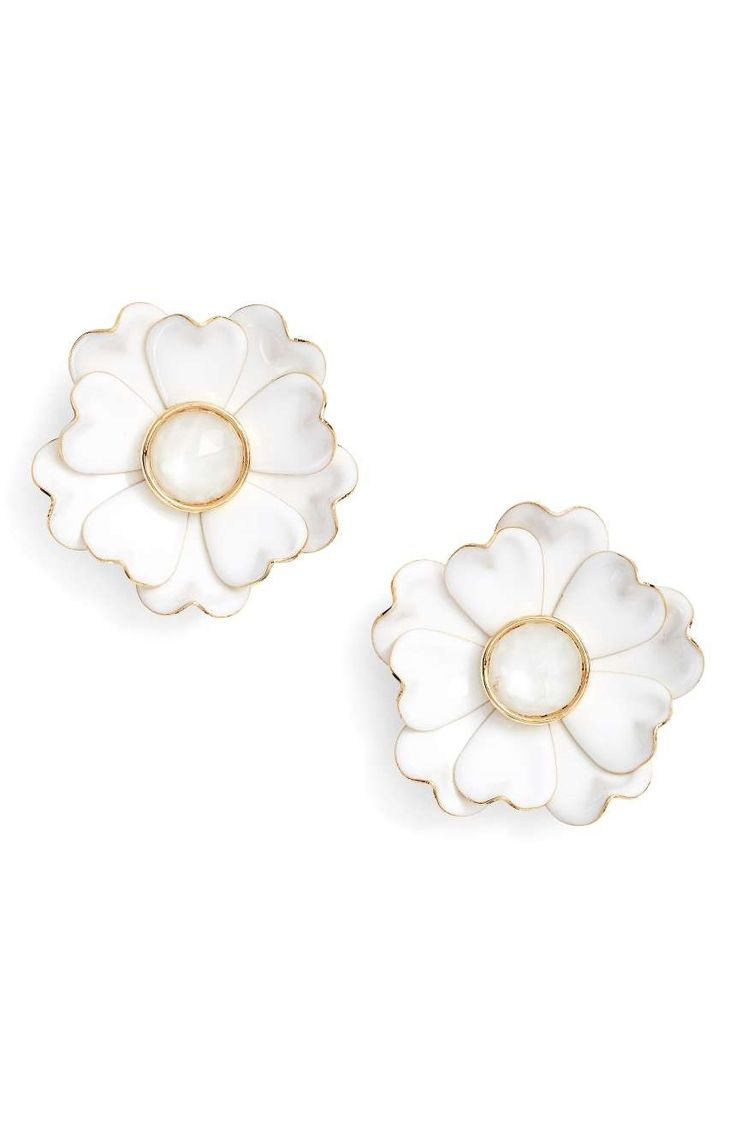 Gracefully folded metallic petals coated with enamel make up these statement-making earrings by Kate Spade.