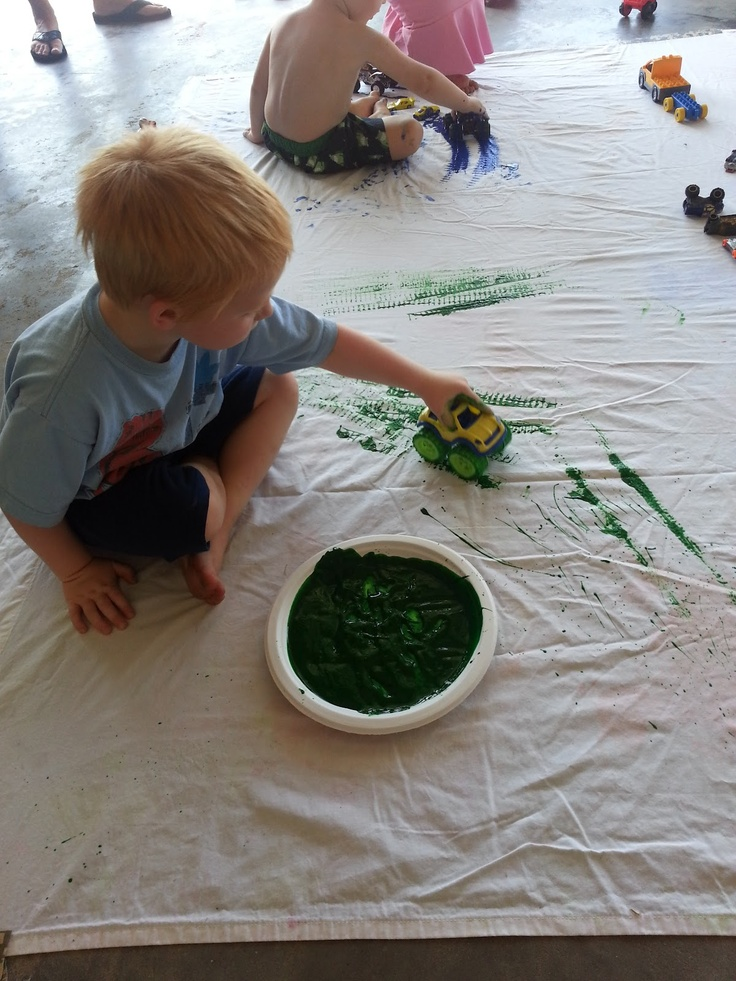 Toy Car Painting and subsequent clean up - a fun outdoor activity while the weather is still warm.