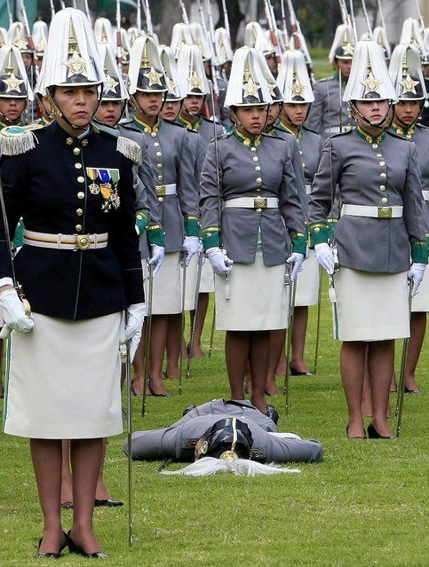 A female cadet, member of the General Francisco de Paula Santander Cadets School, faints during the Colombian Police 121th Anniversary ceremony in Bogota, Colombia, on 2 November 2012. Colombian President, Juan Manuel Santos, and his counterparts from Costa Rica, Laura Chinchilla and Honduras, Porfirio Lobo attended the event. (Photo by Leonardo Munoz/EPA)