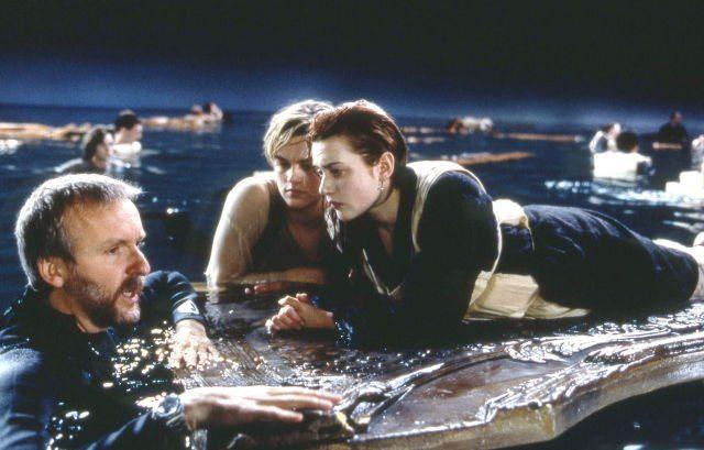 Leonardo DiCaprio, Kate Winslet and James Cameron on the set of Titanic, 1997