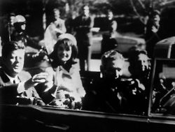 President Kennedy, left, and his wife, Jacqueline, and Texas Gov. John Connally and wife Nellie ride in the Dallas motorcade Nov. 22, 1963.(AFP / AFP/GETTY IMAGES)