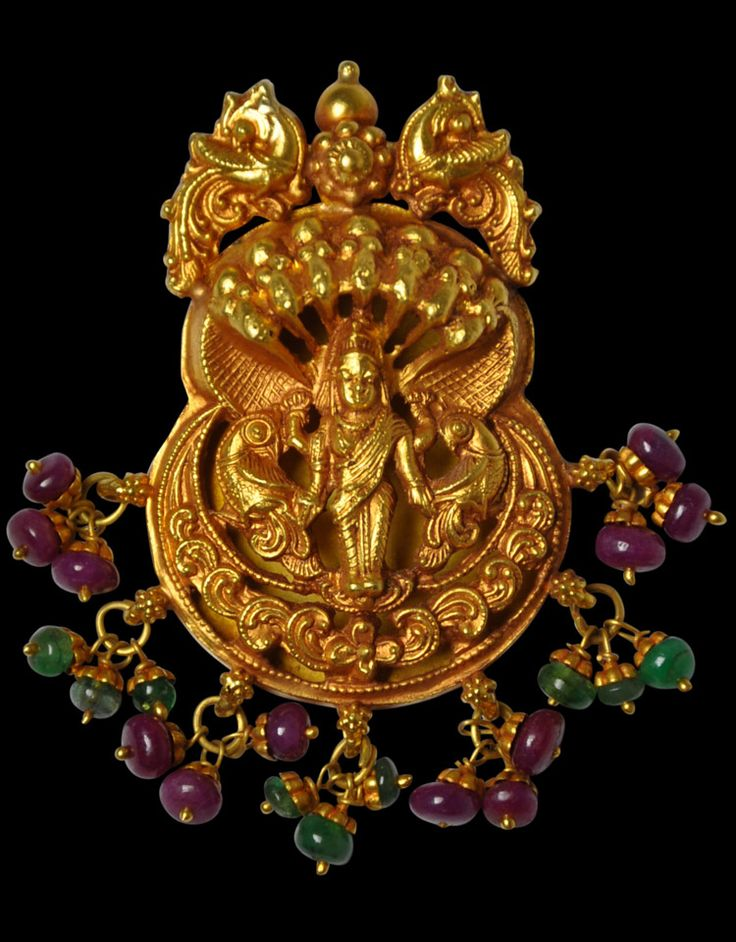 Gold Pendant of Meenakshi with Emeralds & Rubellite. This fine pendant of repoussed and hammered gold sheet shows the deity Meenakshi, the South Indian avatar of the goddess Parvati. The two pairs of parrots shown with the goddess suggest her identity as being Meenkashi. This and more rare jewelry for sale on Curatorseye.com