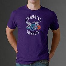 old school Charlotte Hornets logo on a purple T-shirt