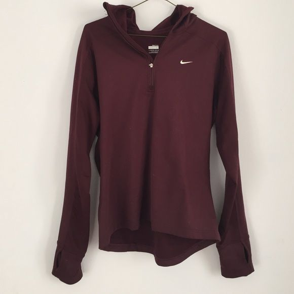 Maroon Nike quarter zip hoodie Maroon colored Nike quarterzip hoodie. It's in great condition just needs to be lint roller lol. It's a girls size 12-14 but easily fits a women's small because it fits me very well. Has a hole for your thumb on both sides and has a hood and is more of a fleece like material on the inside. Nike Tops Sweatshirts & Hoodies