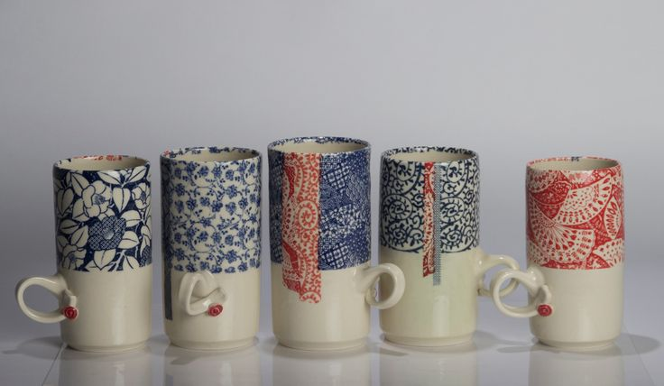 hand decorated thrown mugs