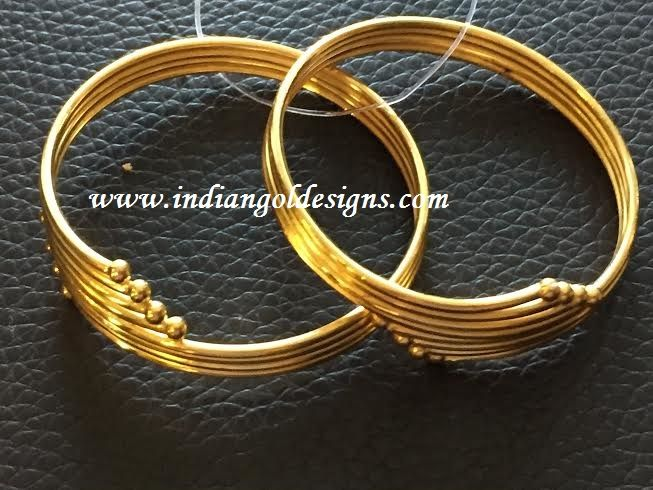 Gold and Diamond jewellery designs: baby gold bangles