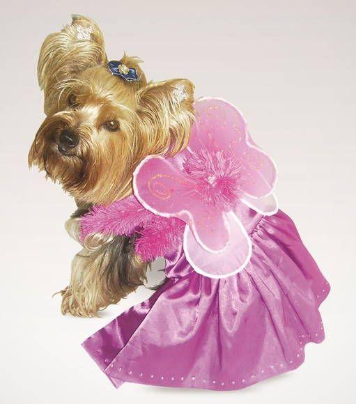 Vestido em cetim com elastano pink, fechado na barriguinha e pescoço por botões de pressão. Acompanha asas feitas artesanalmente.  TAM 01 ao 03 - R$63,00 TAM 04 e 05 - R$77,00 R$ 63,00