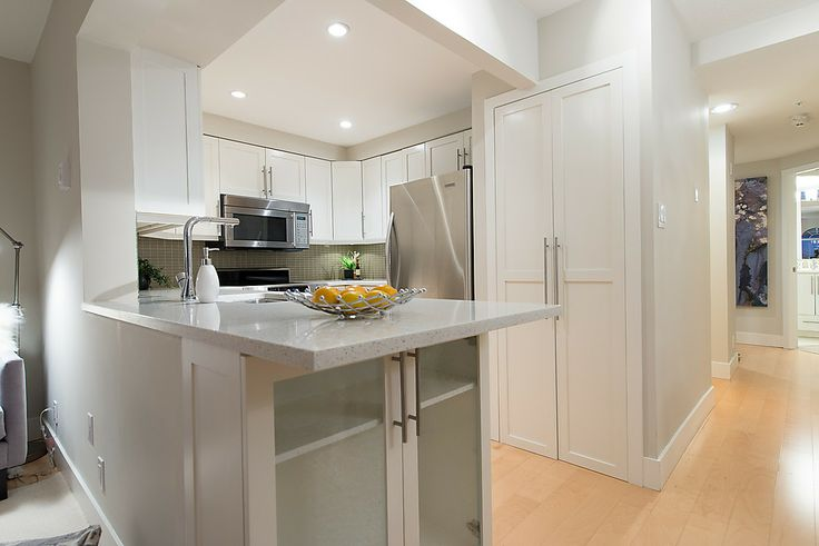 Kitchen was opened and the counters were extended and replaced with Quartz.  Additional cabinets were added for more storage.