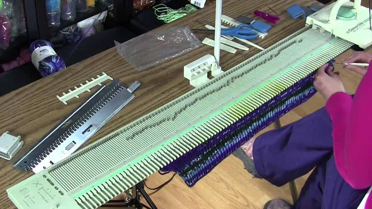 Charity Hat on a bulky, flatbed machine.  BUT... she doesn't really start with the pattern  until almost 4 minutes into the video.  Useful info for a beginner before that but I started watching at 3:50
