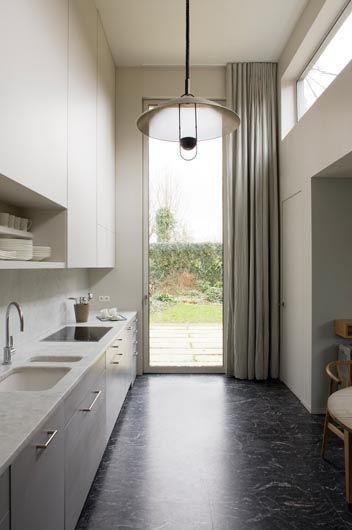 fresh kitchen w high ceiling, great tall glass door w garden view + a lot of light