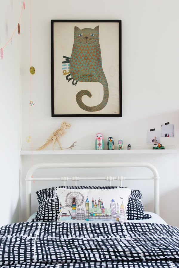 Monochrome and brightly coloured Scandi inspired kids bedroom with IKEA Rast chest of drawers hack with black mountains and black raindrops designs, colorful confetti garlands, tips for Bright Creative Renter Friendly Kids Room Decor, Lulu & Nat neon bunny rabbit bedding and a giant stitched rag rug to cover the boring carpet.