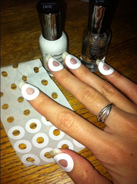 Creating your own french manicure at home! Step 1 put stickers on, step 2 paint white on (a little over sticker), step 3 wait until completely dry and peel off and top with clear coat.  Tadaa! Takes practice and be patience.