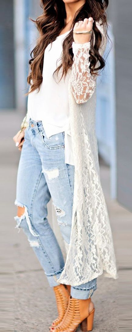 Fantastic Lacey Cardigan. I have not seen a lace cardigan as long before. This piece could be worn in any season. It can be put on, once inside, and the look would be great with anything. Unique !!!