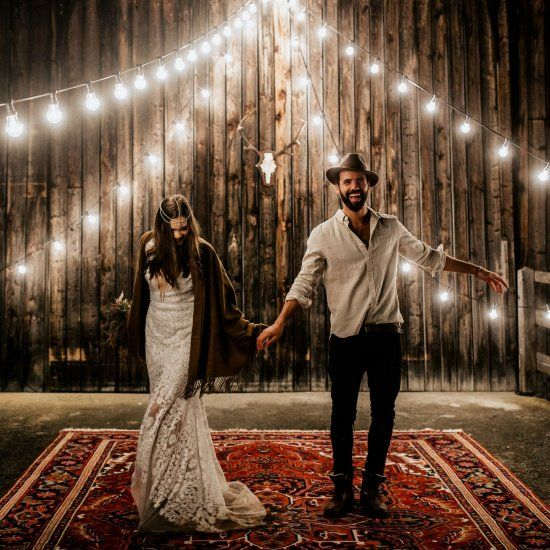Persian rugs, felt hats, macrame, cafe lights - this one's for our boho brides and grooms! Image by Chris and Ruth Photography