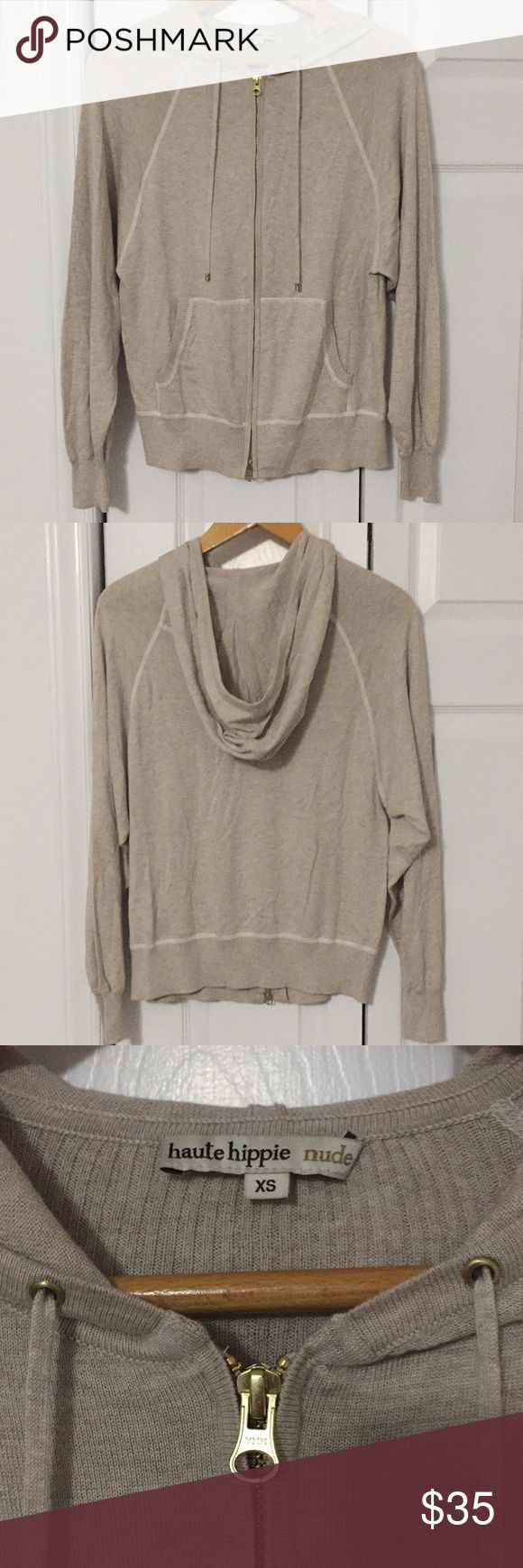 Haute Hippie nude soft zip hoodie Silk,cotton and cashmere blend fabric make this hoodie super soft. Lightweight and great for layering, this neutral piece can be mixed and matched with many other wardrobes essentials. Size extra small with two zipper pulls and pockets. Hood has drawstring. Please let me know if you have any questions and thank you for looking! Haute Hippie Sweaters