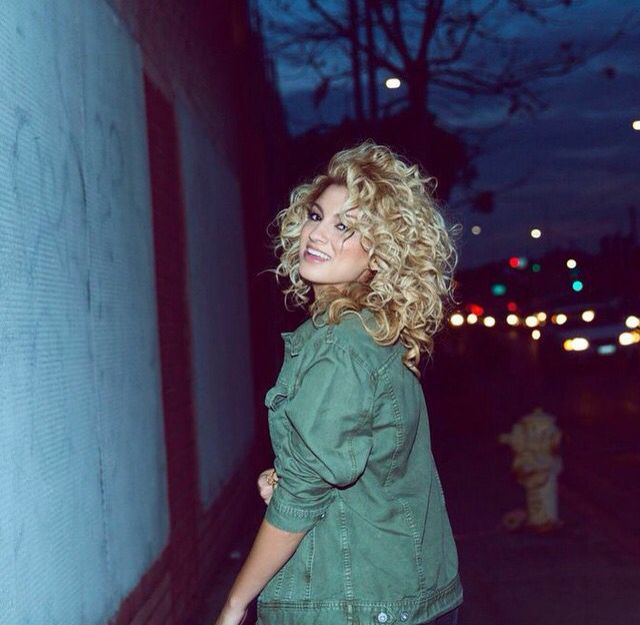 Tori Kelly. Her hair is just amazing, it's beautiful. And her jacket is cute too!