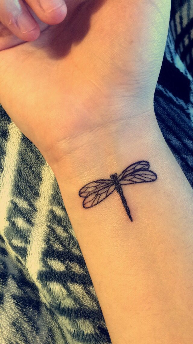 Dragonfly tattoo, wrist.