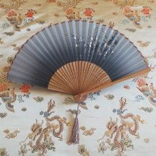 Fan: Oriental Style - Black & White.  The folding fan as we know them today originated in China and Japan 3000 years ago and were picked up by traders to sell to European countries. The Chinese and Japanese cultures created art forms with the fan; dance, opera, ceremonies and social occasions. Highly skilled artist from China and Japan hand paint on wood and paper to create modern fans in the traditional designs.  Bamboo and lace, made in China.   Height 23cm – width 38cm. $13.00au.