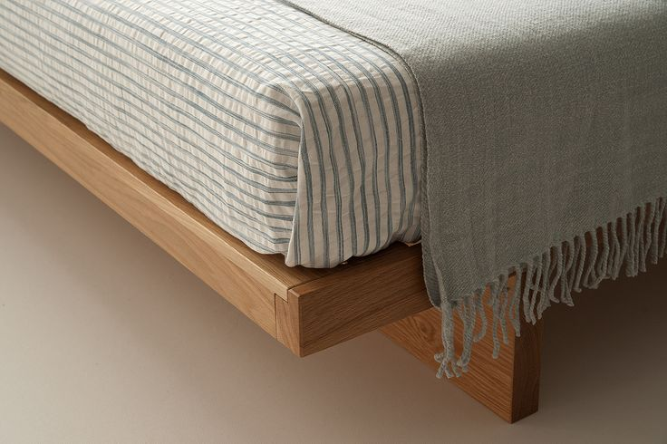 The hand-built Kyoto bed is a low, solid wood, Japanese style bed. Timbers include solid oak, walnut and pine. Made in the UK. Free UK Delivery.