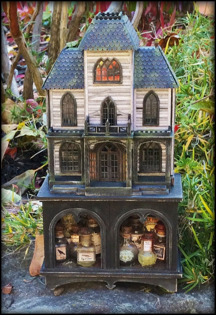 """""""Ravenwood"""" is the third in our series of Secret Houses. This microscale kit includes everything to complete the house and the cabinet, including real windows, shutters and doors. The sides and top op"""