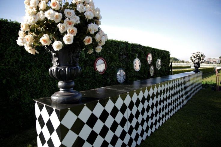 Living wall bar, harlequin bar, clocks, urns, peach roses, chequered, horse race, mad hatters, alice in wonderland, bar