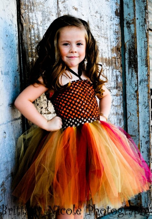 Queen B Creations has adorable tutu dresses. This may be Charleigh's Thanksgiving outfit/Fall picture dress. LOVE IT!
