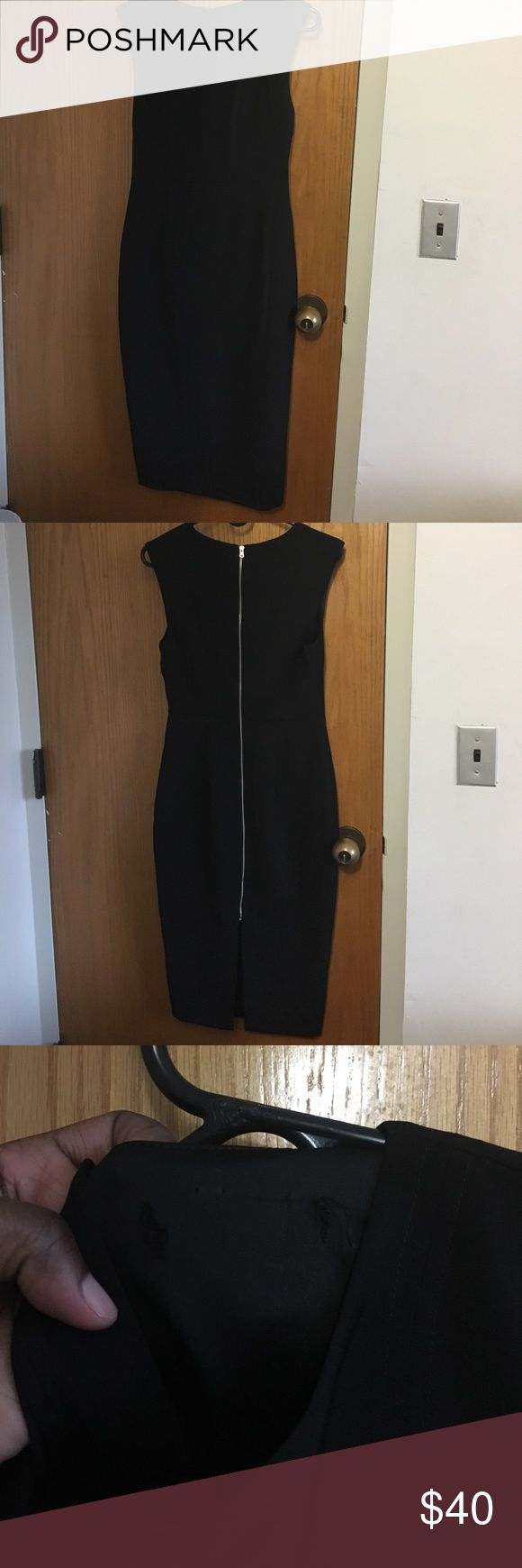 """Black midi-length dress Black, straight midi length dress. Dress was previously dry cleaned and is missing """"express"""" tag on the inside. The third picture is showing the damage where the tag was ripped. I'm not sure why but this is what I noticed when it came back from the dry cleaners. Express Dresses Midi"""