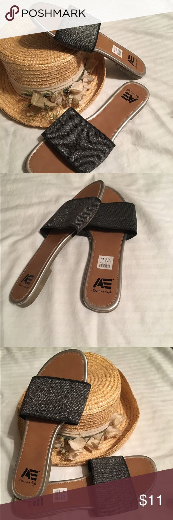 NWT American Eagle Black Sparkly Slide Sandles 9 New with tags Women's American Eagle black Sparkly sandles are size 9. Sandles have Tan insoles and outsoles. Insoles are trimmed in gray. Fabric upper balance man made materials. They are flat with no arch support. American Eagle by Payless Shoes Sandals