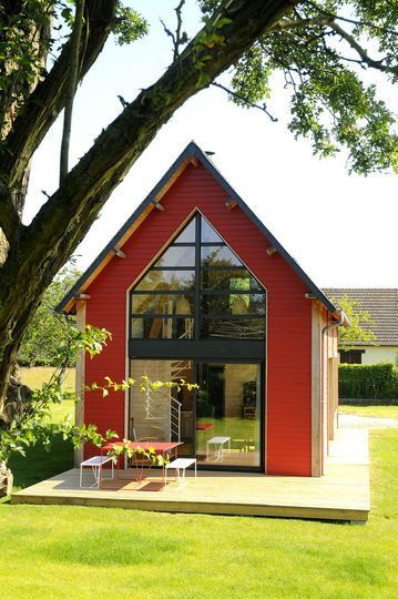 Small holiday home in Normandy. The entire space is wrapped in wood, a light wash on the wood walls distinguishes them from the wheat colored wood floor. Kitchen, living room and one bedroom and bath. http://www.busyboo.com/2014/01/26/small-holiday-home-cm/
