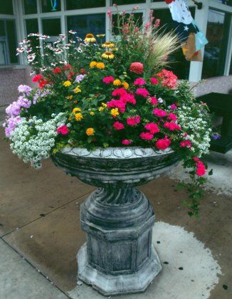 Beautiful Urn...filled with different flowers...maybe a space for a solar light too