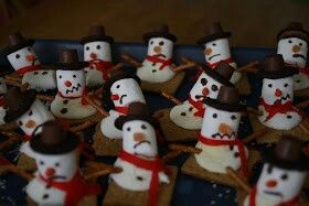 Melted snowmen made from Graham crackers, marshmallows, fruit by the foot, pretzel sticks, Oreos, rolos and tick tacs. Too cute!