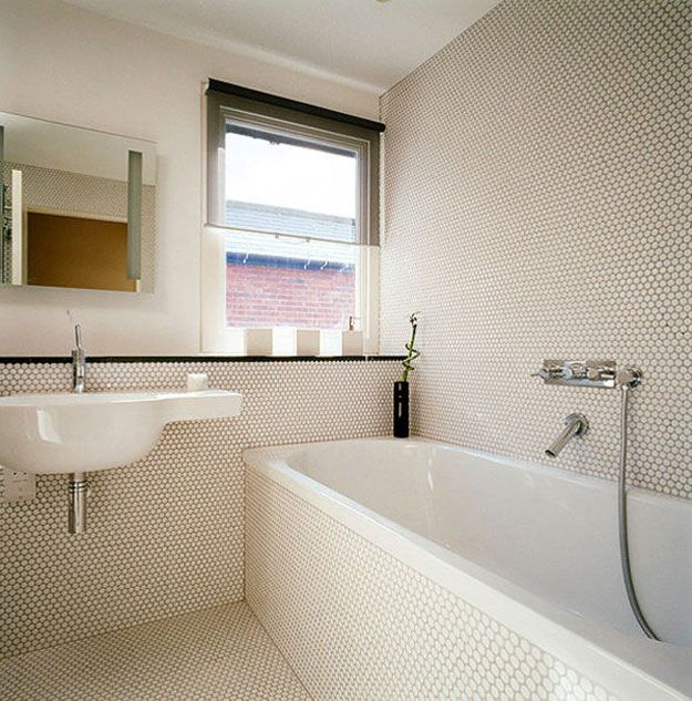 Penny round tiles via Desire to Inspire. Bathroom covered w/ penny rounds