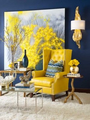 I love the armchair covered in yellow against the dark navy walls. The art sets the color palette for the space bringing cohesion & interest. Lovely...V