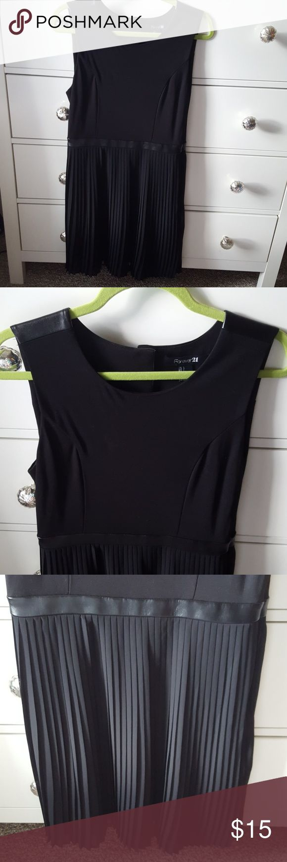 F21 LBD with faux leather accents slightly stretchy top half with faux leather details on the shoulder straps that follows around the upper back witb 3 snap button enclosure.  faux leather belt separates out from the pleated skirt. great condition. fully lined Forever 21 Dresses Mini