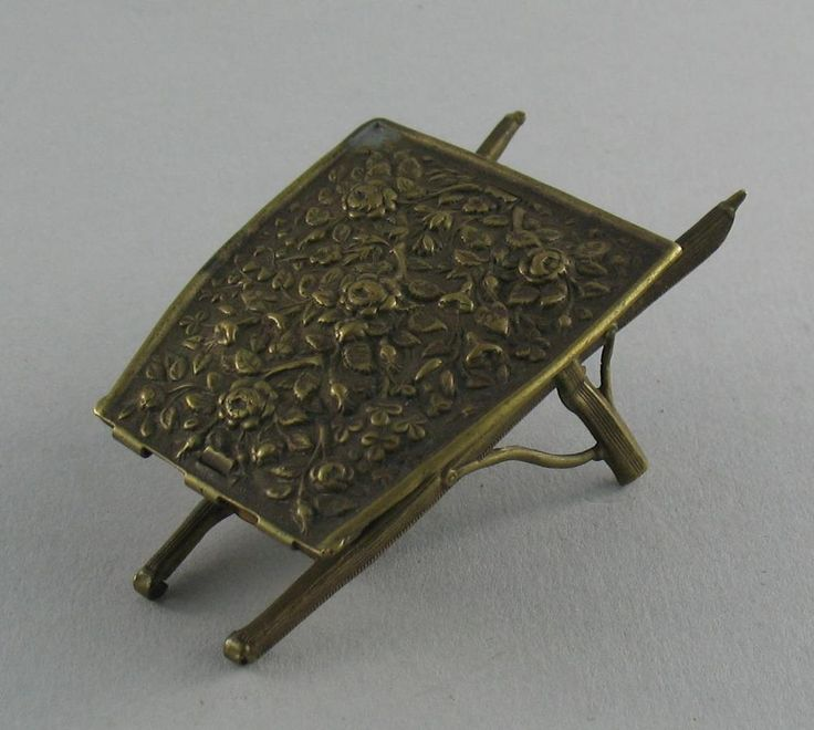 "Antique Victorian W Avery Gilt Brass Roses in Wheelbarrow Needle Case #602 c1874  | eBay  Approx 7"" / 18cm (closed)  Condition : The wheel is missing (the forks & wheel holders are fine with no damage) and the tips of the handles are lost (last 3 photos), otherwise good antique condition with a good catch £49"