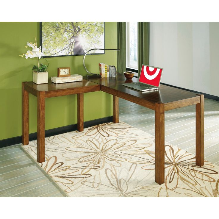 The butcher-block styled desk makes excellent use of space. L-shaped configuration has the option of placing the return on the left or right side—so you're never fenced in by one design.  Signature Design by Ashley is a registered trademark of Ashley Furniture Industries, Inc.