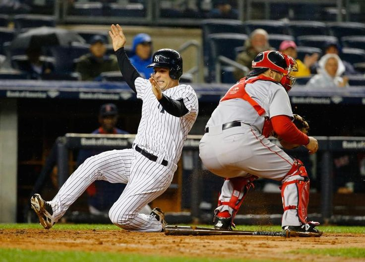 NEW YORK, NY - OCTOBER 01: John Ryan Murphy #66 of the New York Yankees scores a run against Sandy Leon #3 of the Boston Red Sox in the second inning during their game at Yankee Stadium on October 1, 2015 in New York City. (Photo by Al Bello/Getty Images)