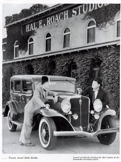 Laurel & Hardy and a Studebaker President Sedan outside the Hal E. Roach Studio..