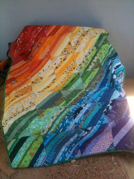 Scrappy rainbow quilt Shared by www.nwquiltingexp... JOIN US Sept 2014! #nwqe #quilting