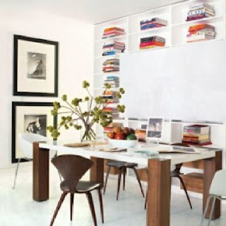 in a dining area designed by juan carlos arciladuque bentplywood chairs by norman cherner mingle with seats from rapture by issakhan is displayed on the