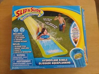 """Wham-O Slip 'N Slide Hydroplane Single with Slide Boogie - Open Box. Wham-O Slip 'N Slide Hydroplane Single with Slide Boogie - Open Box                                                                                  Description This 15 foot water slide with super extended splash pool allows you to actually hydroplane as you slide creating wakes of water and a huge splash! It's classic Slip 'N Slide fun! Features a 15'L x 28""""W slide with a built-in splash pool at the end of the slide, an…"""